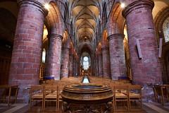 St Magnus Cathedral nave (Mister Electron) Tags: orkney orkneyislands scotland northerly highlandsandislands northernisles nikond800 cathedral stmagnuscathedral kirkwall religion church nave interior sandstone pillars vaultedceiling vaulted font perspective wideangle
