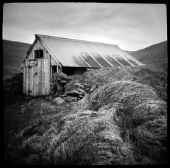 Little Shack on the Tundra (Chuck Baker) Tags: alternative analog abandoned architecture blackandwhite building blackwhite believe camera darkroom door doors eastman film history iceland kodak diana lomography lomo life love lens light monochrome notechography old outdoor outdoors photography photograph plastic peace rural surreal toy trix understanding windows window wall wind z
