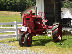 McCormick Deering Farmall Tractor. (dccradio) Tags: june summer summertime wednesday wednesdayafternoon afternoon goodafternoon grass lawn greenery tractor oldtractor antiquetractor classictractor vintagetractor fence whitefence field tree trees barn calf calfbarn cow cows stones gravel nikon coolpix l340 bridgecamera old antique vintage classic mccormickdeering farmall internationalharvester farm farming ag agriculture agricultural