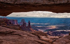 Looking Through a Portal of Mesa Arch to Views of Canyonlands National Park (HDR, Canyonlands National Park) (thor_mark ) Tags: airporttower aurorahdr aurorahdrpro azimuth90 buckcanyon canvas canyon canyonwalls canyonlands canyonlandsnationalpark canyons capturenx2edited centralcanyonlands colorefexpro coloradoplateau day5 desertlandscape desertmountainlandscape eccezionale hdr highdesert intermountainwest islandinthesky islandintheskydistrict lasalmountains landscape layersofrock lookingeast mesaarch mesaarcharea middlefork monstertower mostlycloudy nature nikond800e outside overcast portallikeview portalview portfolio project365 sandcastletower sandstonetower sandstonetowers singleimagehdr utahhighdesert utahnationalparks2017 walktomesaarch washerwoman washerwomanarch washerwomanarchmonstertower utah itedstates