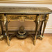 Gilded antique wall table with faces
