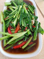 Stir-fried Chinese kale at The White House in Phon Phisai 1 (SierraSunrise) Tags: thailand phonphisai nongkhai isaan esarn food chilies solanaceae brassicaceae stirfry green red restaurant dining