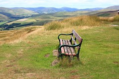 LONESOME. (the water watcher 05.) Tags: langholm scotland dumfriesshire galloway borders canon 450d bench seat hilltop tarras moor whita hill green blue rolling hills ewes valley eskdale moorland sedge grass nature landscape vista view summer terrona water watcher 05 brown sky clouds august 2018