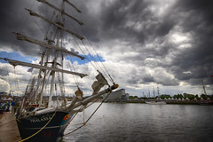 """colour fine art: summer storm clouds threaten the Rouen Armada (Tall ships) on the Seine. Rouen, Seine-Maritime, Normandie, France (grumpybaldprof) Tags: canon 80d """"canon80d"""" sigma 1020 1020mm f456 """"sigma1020mmf456dchsm"""" """"wideangle"""" ultrawide """"fineart"""" striking artistic interpretation impressionist stylistic style contrast shadow bright dark black white illuminated mood moody atmosphere atmospheric rouen seinemaritime normandie france seine """"seineriver"""" city veliocasses gauls rotomagus 912ad normandy """"joanofarc"""" neustria normans 1449ad french """"rouenarmada"""" """"rouentallships"""" sailing ships """"sailingships"""" sails ropes rigging masts hulls armada quayside international sailors visitors celebration """"grandsvoiliers"""" voiliers mat voile greement quai harbour port bassin bateaux corde"""