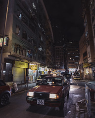Kwun Tong, HK (mikemikecat) Tags: ç´è² moody 觀塘 parking outdoors residential district city street no people road building illuminated night built structure exterior land vehicle transportation architecture mode motor car hong kong old town buildings one man only person taxi driver kwun tong nigh moodygrams bladerunner mikemikecat voigtlander 21mm vm21