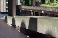 Barbican light (Spannarama) Tags: sunlight sunshine shadow lightanddark lightandshade concrete wall brutalist architecture modernist textures lamp streetlamp streetlight shadows barbican ramp fannstreet london uk vintagelens helios442 58mm filmlens