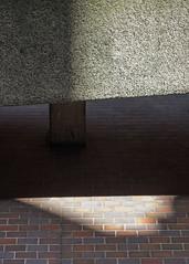 Barbican light (Spannarama) Tags: sunlight sunshine shadow lightanddark lightandshade concrete wall brutalist architecture modernist textures barbican ramp fannstreet london uk vintagelens helios442 58mm filmlens
