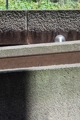 Barbican light (Spannarama) Tags: sunlight sunshine shadow lightanddark lightandshade concrete wall brutalist architecture modernist textures lamp streetlamp streetlight glassshade sphere barbican ramp fannstreet london uk vintagelens helios442 58mm filmlens