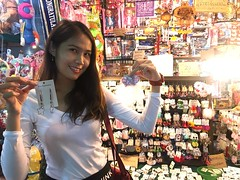 trying earrings (ChalidaTour) Tags: thailand thai asia asian bangkok night market street friend girl sweet cute pretty sexy teen happyplanet asiafavorites