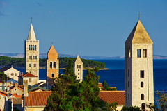 Four bell towers of Rab, Croatia (Bokeh & Travel) Tags: architecture rab islandofrab dalmatia croatia kroatien adriatic mediterranean belltower beautiful colourful sunsetcolors sunsetlight pov summer vacation