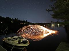 kayak on fire (scienceduck) Tags: scienceduck 2019 june canadaday lakemuldrew muldrew muskoka wideangle night fire sparks steelwool longexposure water lake boat