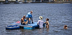 """""""Dry land is that way"""" (LarryJay99 ) Tags: fourthofjuly july4th2019 lakeworth barge shirtless tatts tattoos crossedlegs bald water beads seated sittingpretty legs drinking delraybeach florida wadding wet blue people urban watersedge"""