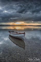Boat (Ken Duke Photography) Tags: sunset clouds reflection shore sky sun lake ireland water serene