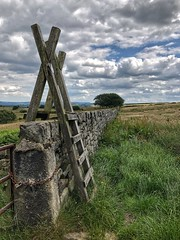Yorkshire Style Stile (Mr_Pudd) Tags: wood grass wall stile drystonewall huddersfield moorland meltham iphone deerhill iphonephotography woodenstile gate lock chain gateway padlock gatepost sky cloud tree clouds portraitformatlandscape portraitlandscape ladderstile