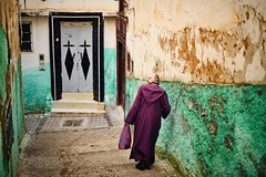 A local woman walking passs old green wall (snowpine) Tags: street streetphotography streetportrait candid people green purple old wall oldtown morocco nikond850