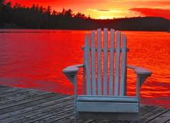 sunset awaits on the dock - Lake Temagami, Ontario Canada (jeffglobalwanderer) Tags: deckchair chair seat seating dock muskokachair adirondakchair northernontario laketemagami canada sunset sunsetglow pinksky reflection lakeshore beautifulontario