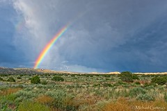 Summer Shower and Rainbow (in explore) (Michael Guttman) Tags: rainbow partialrainbow openfield field thunderstorm storm stormclouds summerrain shower newmexico sky skydrama rainshower nature openspaces bigsky clouds
