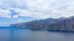 "View from the ocean on the cliffs of Los Gigantes on Tenerife, Canary Islands, Spain (dronepicr) Tags: hike allgemein city wanderlust natur kanaren archipelago ""aerialviewtravel"" drone wandern mavic island stadt kanarische inseln teneriffa länderstädte insel geotagged landscape schönste strände luftbild strandurlaub bay spain sightseeing tenerife aerial ferien uav hiking wanderurlaub la gomera foto beach macaronesia strand travel urlaub luftbildreise ""birdseyeview"" canary islands vogelperspektive drohne holiday spanien ballermann"