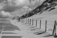 sand covers ... (Woewwesch) Tags: summer sand clouds dunes beach blackwhite wind bike cover change ocean northsea netherlands langevelderslag july