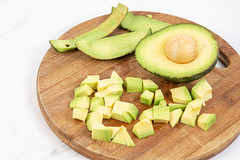 Sliced Avocado on the kitchen cutting board (wuestenigel) Tags: half natural color exotic nature dieting background plant delicious peel core ripe isolated stack organic vegetable eating avocado whole closeup section nutrition healthy vegetarian diet cut whitebackground food slice ingredient green raw seed freshness health vitamin fresh fruit tropical white