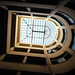 Upward perspective of U-shaped skylight inside the inner garden in Athens, Greece