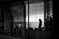 Parallel world (明遊快) Tags: monochrome bw urban building city cityscape sunlight shadows man silhouette lines contrast reflections candid japan happyplanet asiafavorites