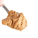 Peanut Butter on the spoon above white background