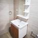 Bathroom sink with mirror and shelf