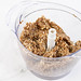 Mixture for Energy Balls with Date Palm fruits Almonds and Hazelnuts in the bowl