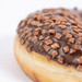 Closeup Macro of Chocolate Donut on the white background