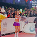 Female cheerleader in costume cheering at the finish line for runners at Mainova Frankfurt Marathon in Germany