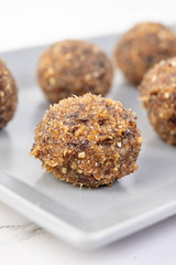 Closeup of Energy Balls with Walnuts Palm Dates and Sesame (wuestenigel) Tags: date bite ball cacao space background snack fitness truffles homemade golden nutty protein energy bar raw chocolate group walnut rolled breakfast honey oatmeal healthy vegan diet peanut organic food vegetarian sesame carob oat nut dessert round seeds sweet fruit tasty almond