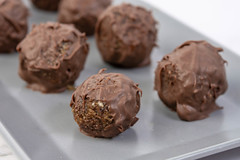 Energy Balls with Chocolate Glaze on the plate (wuestenigel) Tags: date bite ball cacao background snack fitness delicious truffle candy homemade horizontal cocoa organic raw chocolate coconut group wooden closeup breakfast plate healthy vegetarian gourmet peanut vegan food diet energy protein dessert nut round seeds sweet rolled tasty pastry almond