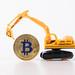 Yellow digger with golden Bitcoin