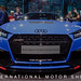Car enthusiasts of all generations at the International Motor Show IAA, around a blue Audi Sport Performance Parts