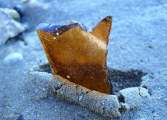 Broken Glass....DANGER....Macro Mondays (Lani Elliott) Tags: macro bokeh upclose closeup beach foreshore howden sand pebbles light bright glass danger macromondays