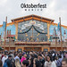 Hacker-Festzelt and decorated, enormous beer tent with crowd in front of it, at Oktoberfest Munich