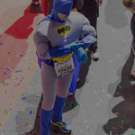 Man in Batman costume finished Frankfurt Marathon and is surrounded by confetti thumbnail