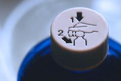 blue danger (HansHolt) Tags: bottle methylatedspirit denaturedalcohol spiritus safetycap cap arrow arrows 1 push down 2 turn left white blue child resistant proof dof tabletop macro canon 6d canoneos6d canonef100mmf28macrousm macromondays danger hmm