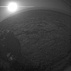 Sunset from the Rear, variant (sjrankin) Tags: 8july2019 edited nasa mars msl curiosity galecrater dust sand rocks grayscale sun sunset wheel mountains craterrim craterfloor glare haze sky rlb615805611edrf0761714rhaz00311m