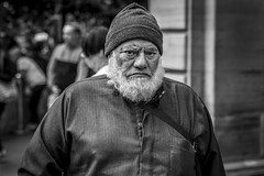 Mood (Leanne Boulton) Tags: urban street candid portrait portraiture streetphotography candidstreetphotography candidportrait streetportrait eyecontact candideyecontact streetlife old elderly man male face eyes mouth expression beard emotion mood feeling beanie grumpy moody angry sad emotional character tone texture detail depthoffield bokeh naturallight outdoor light shade city scene human life living humanity society culture lifestyle people canon canon5dmkiii 70mm ef2470mmf28liiusm black white blackwhite bw mono blackandwhite monochrome glasgow scotland uk