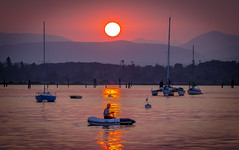 Cowichan Bay Sunset (Paul Rioux) Tags: cowichan bay sunset evening sun row boat person calm water orange haze sail prioux