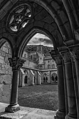 Monasterio Irantzu (tonygimenez) Tags: piedras monasterios claustro nubes arcos iglesias españa navarra jardín edificios ventanas torre campanario