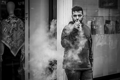 Dragon Breath (Leanne Boulton) Tags: urban street candid portrait portraiture streetphotography candidstreetphotography candidportrait streetportrait eyecontact candideyecontact streetlife man male face expression eyes mood emotion atmosphere feeling smoke smoker smoking ecig electroniccigarette vape vaper vapour vaping eliquid subohm cloud tone texture detail depthoffield bokeh naturallight outdoor light shade shadow city scene human life living humanity society culture lifestyle people canon canon5dmkiii 70mm ef2470mmf28liiusm black white blackwhite bw mono blackandwhite monochrome glasgow scotland uk