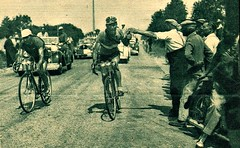 1949 TDF Bernard Gauthier grabs his drinking can in full flight... (Sallanches 1964) Tags: tourdefrance 1949 chassepatate solitary lagrandeboucle thirsty drinkbottle roadcycling bikerace
