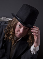 Tipping The Tophat (JohnlockedDancer) Tags: me tophat photography people portraits model portrait genderbender alterego formal attire hand bust chair sitting posing pose curls person one suit cool pretty gender shirt background swedish sweden girl woman youngwoman youngwomanposing nicehair ohlookitsme