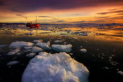 Ilulissat Icefjord (yan08865) Tags: icebergs boat greenland ice water sea ocean arctic ilulissat waterfront travel glaciers nature calving ship rocks sunset midnight pavlis photographers canon landscapes seascapes circle earth awesome zodiac tour nuuk mountains seascape video aerial dji capture icefjord