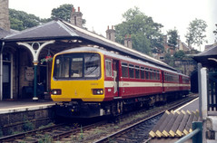144019-Knaresborough-1990s (citytransportinfo) Tags: train railway pacer class144 144019 knaresborough station platform hangingbasket canopy metrotrain regionalrailways britishrail