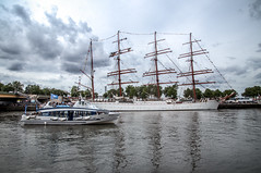 """the new and the old, on the Seine river with the Rouen armada colour fine art: summer storm clouds threaten the Rouen Armada (Tall ships) on the Seine. Rouen, Seine-Maritime, Normandie, France (grumpybaldprof) Tags: canon 80d """"canon80d"""" tamron 16300 16300mm """"tamron16300mmf3563diiivcpzdb016"""" artistic interpretation impressionist stylistic style mood calm peaceful tranquil restful colour rouen seinemaritime normandie france seine """"seineriver"""" city veliocasses gauls rotomagus 912ad normandy """"joanofarc"""" neustria normans 1449ad french """"rouenarmada"""" """"rouentallships"""" sailing ships """"sailingships"""" sails ropes rigging masts hulls armada quayside international sailors visitors celebration """"grandsvoiliers"""" voiliers mat voile greement quai harbour port bassin bateaux corde oldandnew old new"""