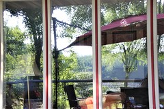 Our Backyard Reflected (birdsetcetera) Tags: backyard reflected umbrella deck berriencountymichigan buchananmichigan reflection reflective mirrorimage windows